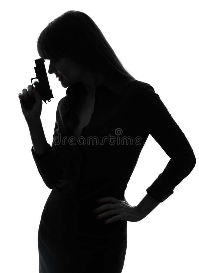 detective woman holding aiming gun silhouette stock photo