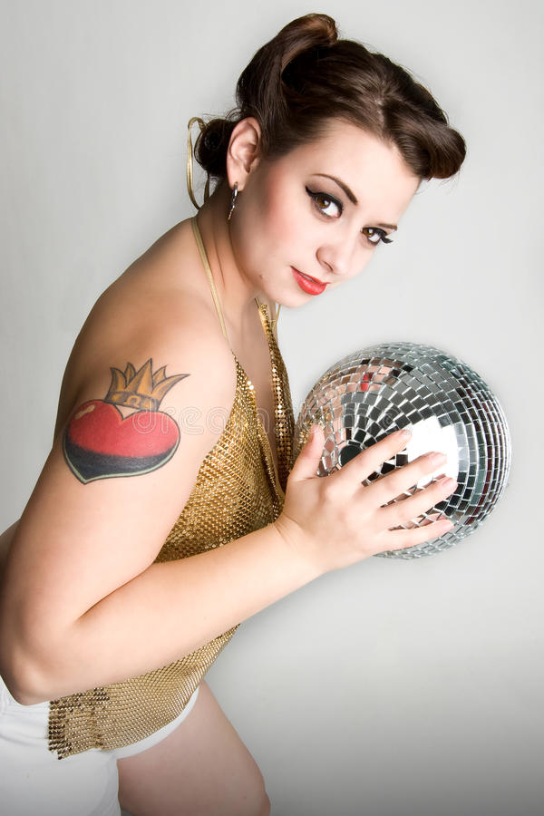 Disco girl. Girl holding mirrored disco ball royalty free stock images