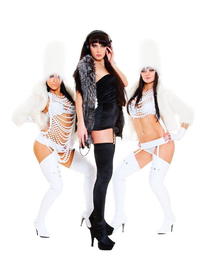 Dj with go-go girls. Portrait of dj with go-go girls over white background stock photos