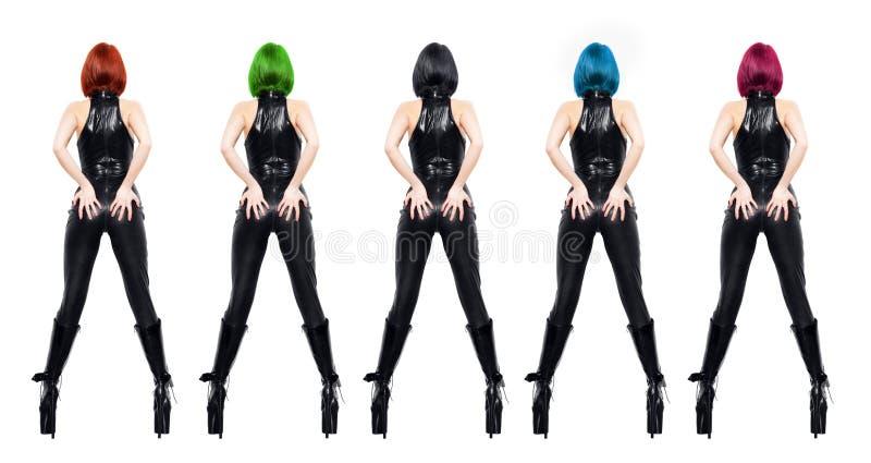 Sexy dominatrixes mit der verschiedenen Farbe des Haares lokalisiert lizenzfreie stockbilder