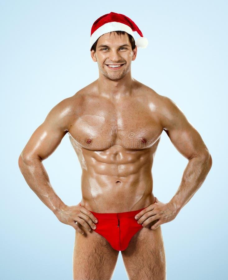 Sexy Eignung Weihnachtsmann stockfotos