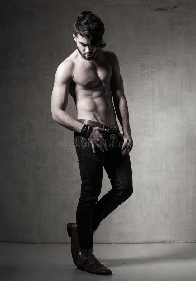 fashion man model top naked posing dramatic against grunge wall royalty free stock photo