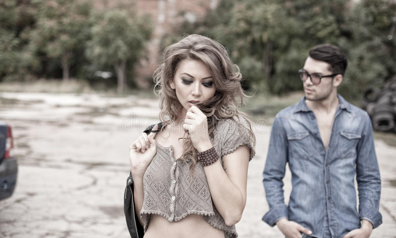 and fashionable couple wearing jeans dramatic stock images