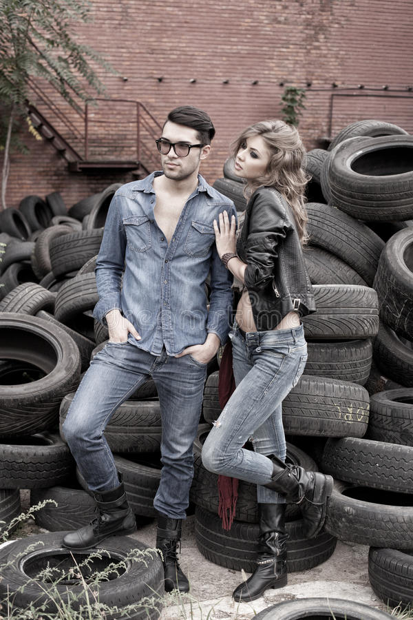 and fashionable couple wearing jeans dramatic royalty free stock photo