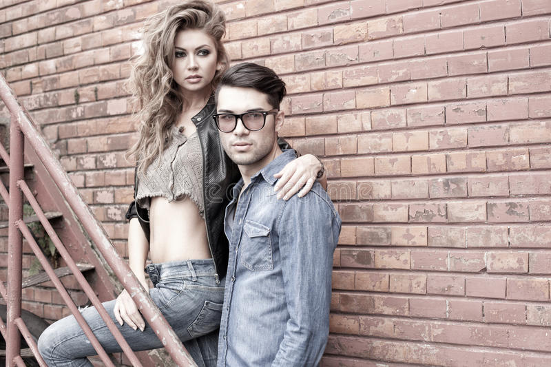 and fashionable couple wearing jeans dramatic royalty free stock photography