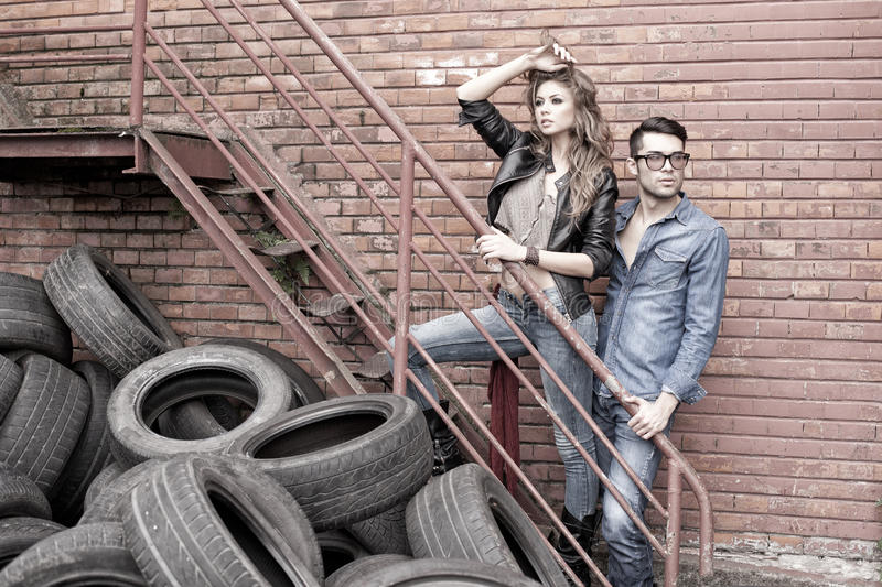 and fashionable couple wearing jeans dramatic royalty free stock images