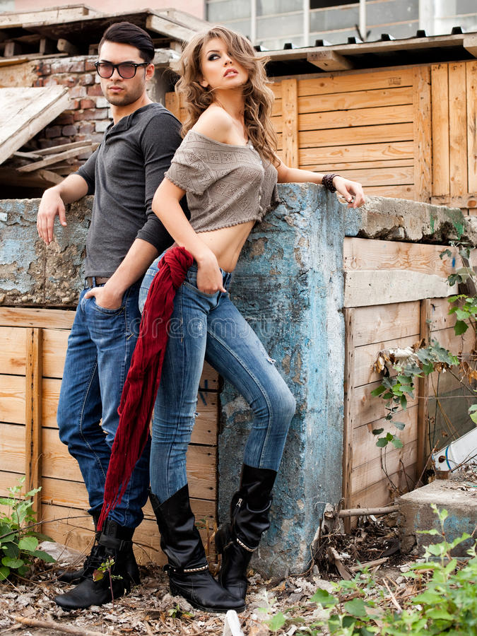 fashionable couple wearing jeans posing dramatic stock images