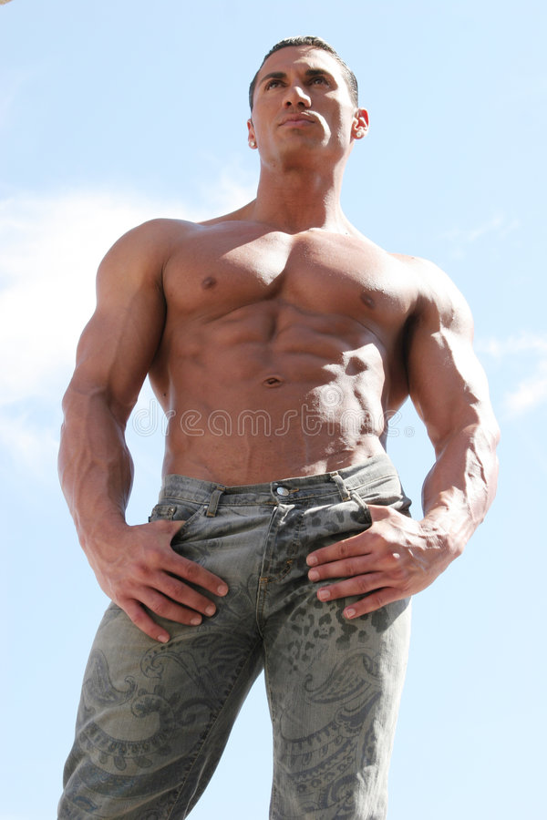 fashionable male model in blue jeans royalty free stock images