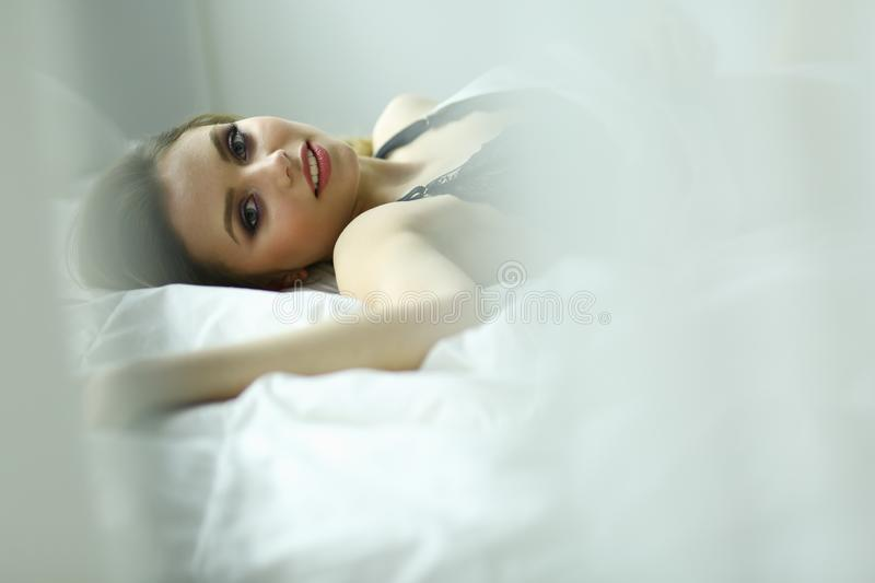 Sexy fashionable woman on the bed stock photography