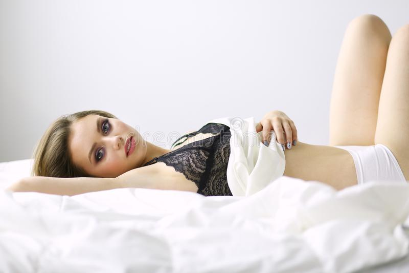 Sexy fashionable woman on the bed royalty free stock images