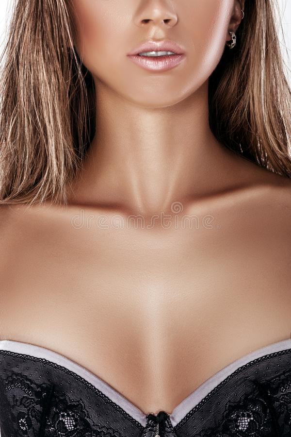 female breast in lace bra stock photography