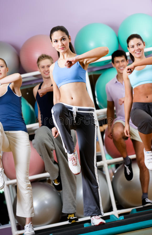 female coach does exercises with her group stock images