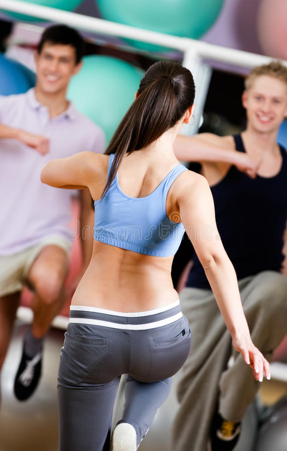 Download Female Coach Exercises With Her Group Stock Photo - Image: 26548086