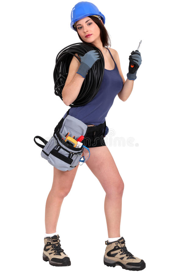 Female electrician. Wearing shorts royalty free stock images