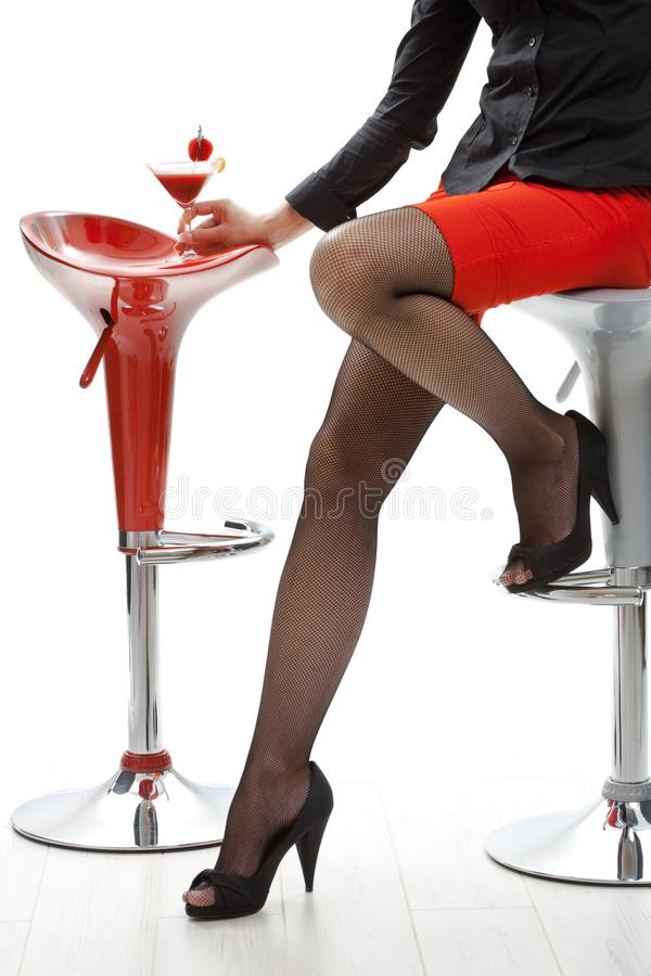 Female Legs In High Heels At Cocktail Bar Stock Photo