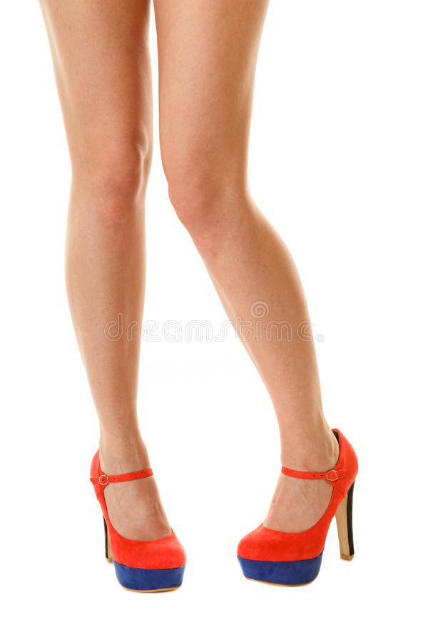 female legs in high heels isolated. Part of body. stock image