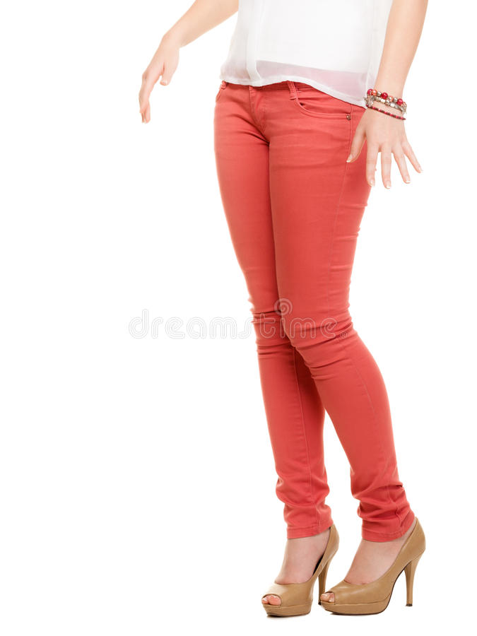 female legs in red pants and beige high heels stock images