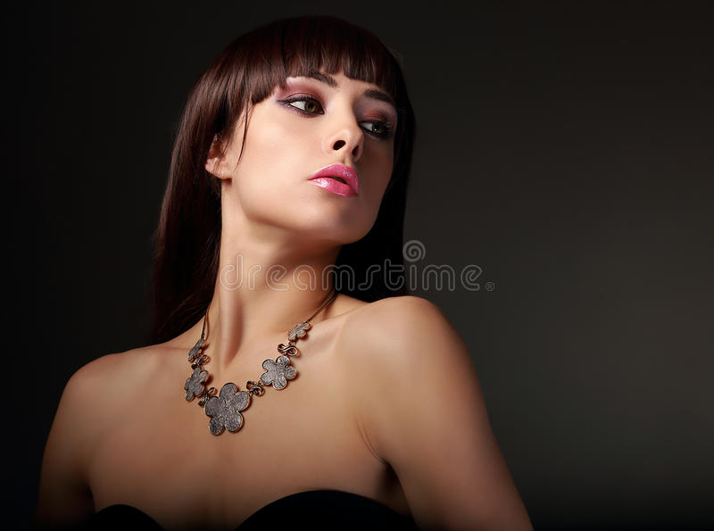 female model in fashion necklace on dark stock images