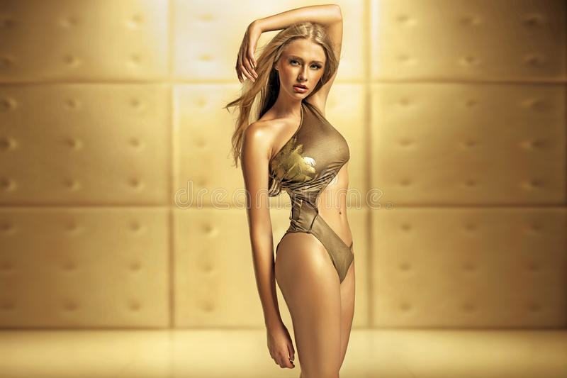 Download Female Model In Golden Swimsuit Stock Photo - Image: 32062800
