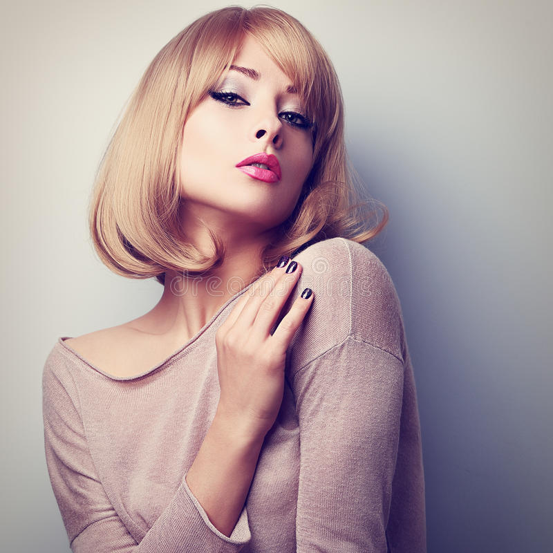 Female model posing with blond short hair style. Color tone. D closeup portrait stock photos