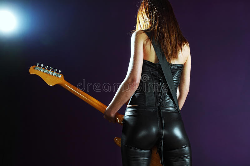 female playing an electric guitar royalty free stock photography