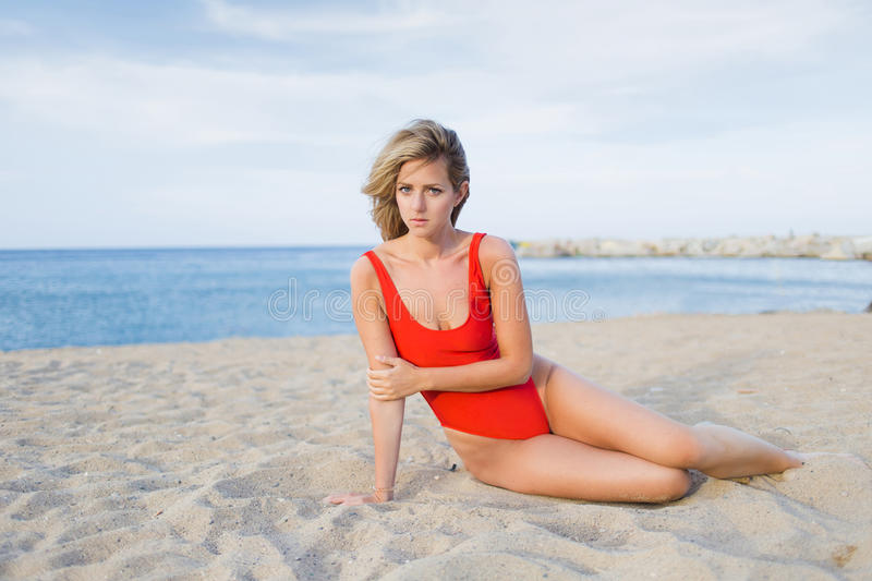 Female in swimsuit enjoying vacation. Woman with beautiful figure dressed in bikini posing for the camera against blue sea and sky background with copy space royalty free stock photography