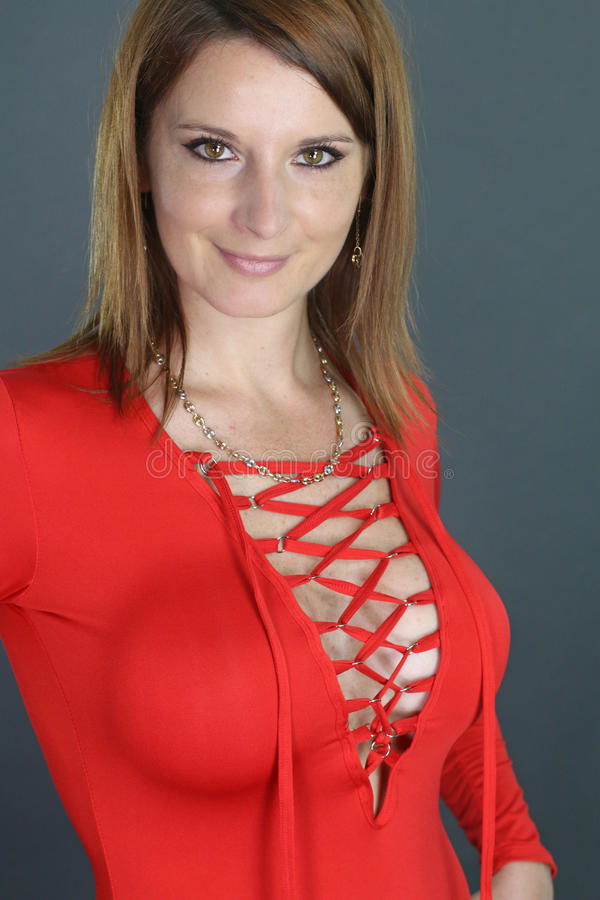 Female wearing a tight dress. Over a gray background stock photos