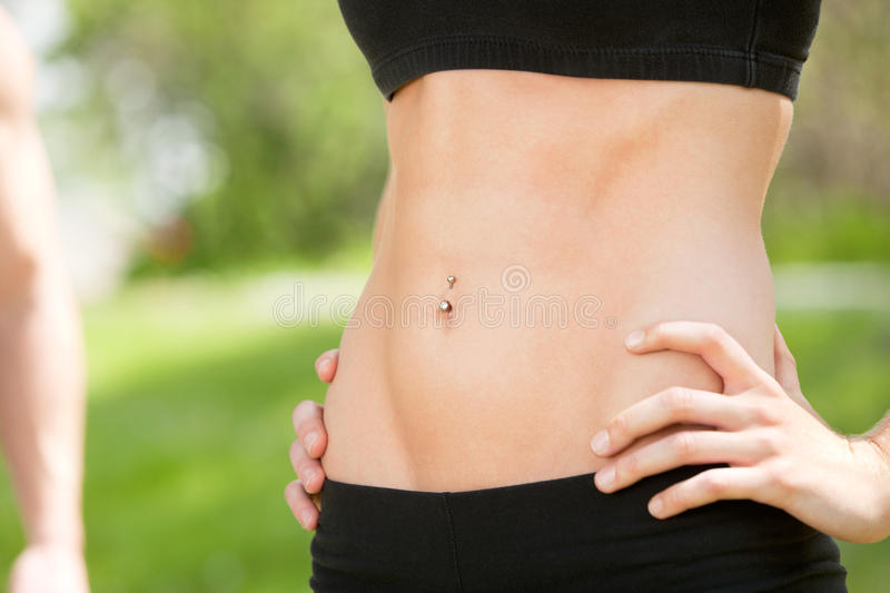 Download And Fit Belly On Young Woman Stock Photo - Image: 18284414