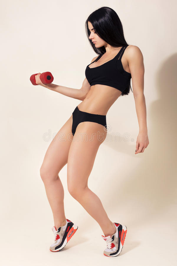 fit brunette woman in sportswear do exercise stock photos