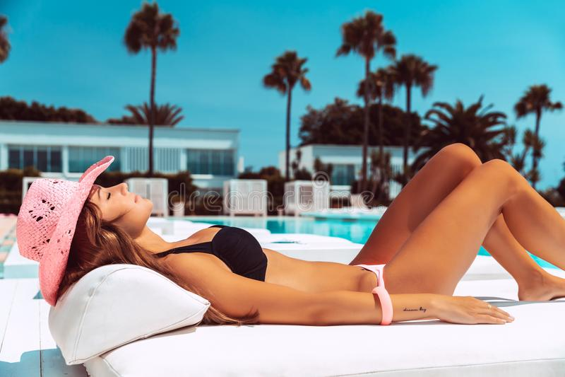Sexy fit woman in luxury vacation stock photos