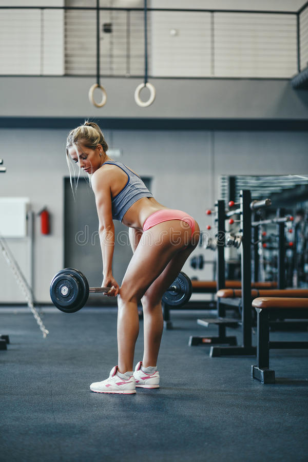fitness happy blonde girl in sport wear with perfect body in the gym posing and smiling royalty free stock photos