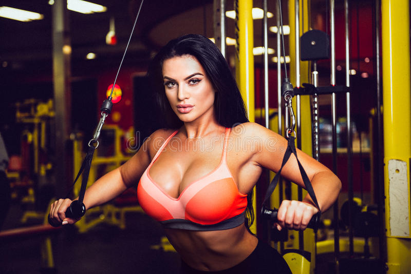 fitness model doing sport exercise in gym stock images
