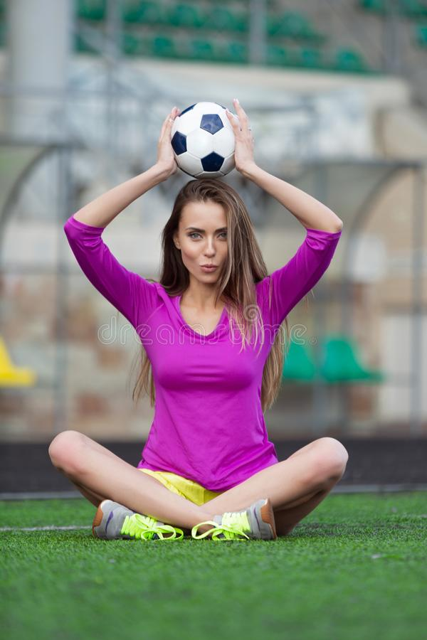 fitness woman or cheerleader with a soccer ball stock images