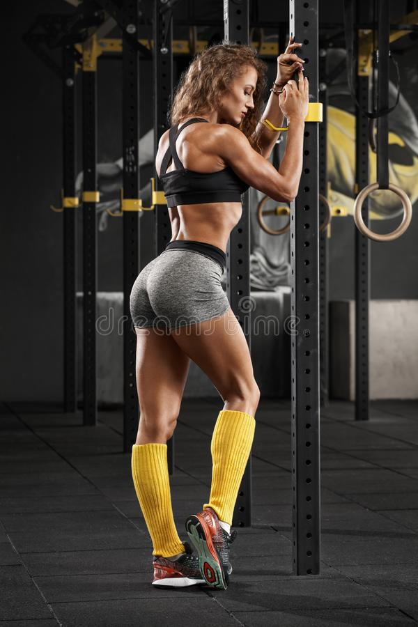 fitness woman in gym. Sporty muscular girl, workout stock photography