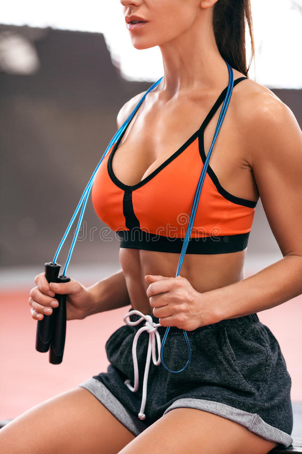 fitness woman with skipping rope, workout. Beautiful athletic girl, sports concept stock photo