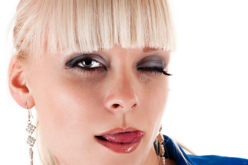 Sexy Frau, die Lippen leckt stockbilder