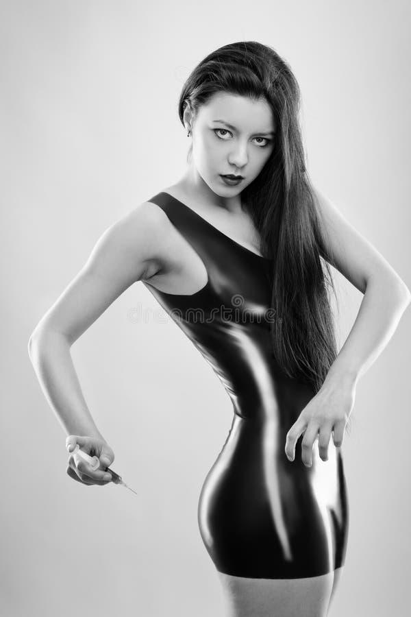 Sexy Frau im Latex stockfoto