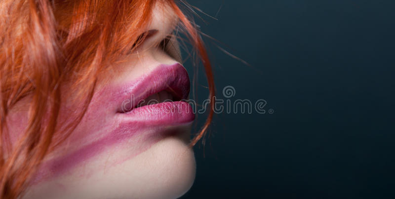 Full lips of female with smudged lipstick. Full lips of young female with smudged lipstick with copy text space in close up royalty free stock photos