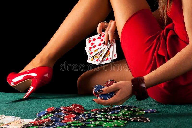Gambling woman. A gambling woman with a poker royal flush stock image