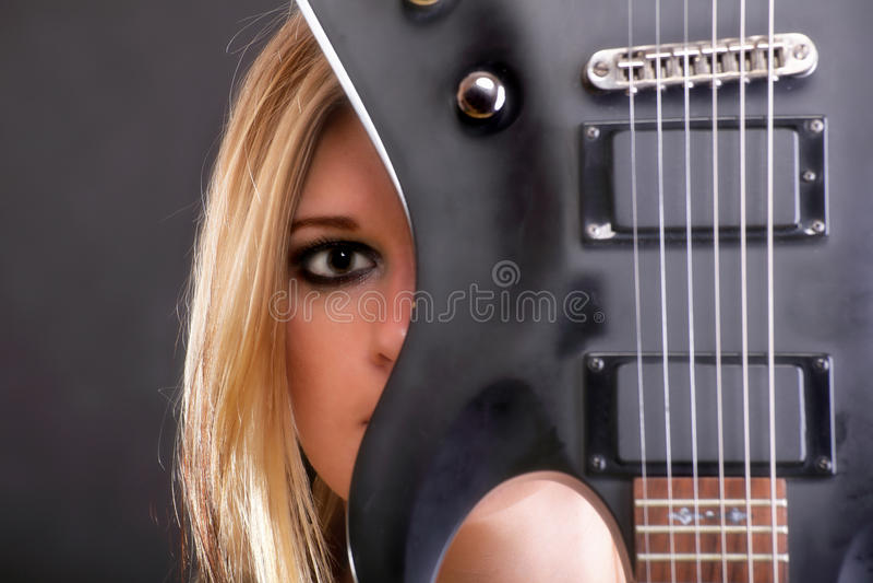 Sexy Gesichtsmädchen und Gitarren-Frau stockbilder