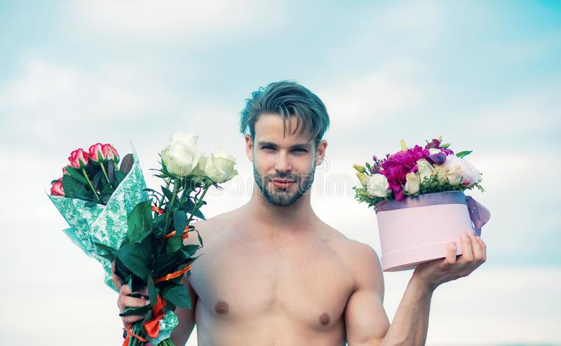 Sexy gift for beautiful woman. 8 march and womans day. A man is giving a beautiful bouquet and gift box to woman. Sexy stock photography