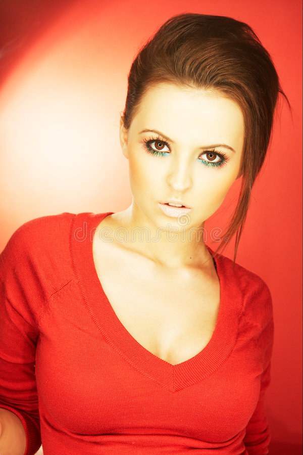 Girl. On red background royalty free stock photography