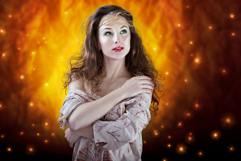girl on abstract flame background. glamour skin and make up royalty free stock images