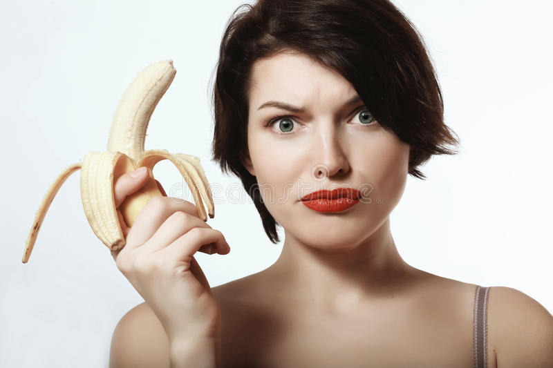 girl with a banana. Underwear. Makeup. Emotions. stock photo