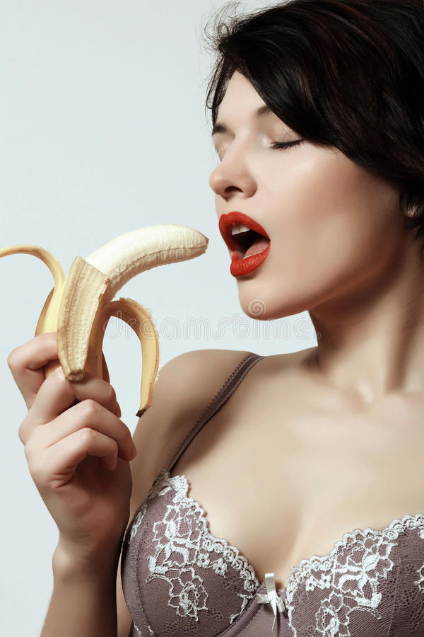 girl with a banana. Underwear. Makeup. Emotions. Passion. royalty free stock photo