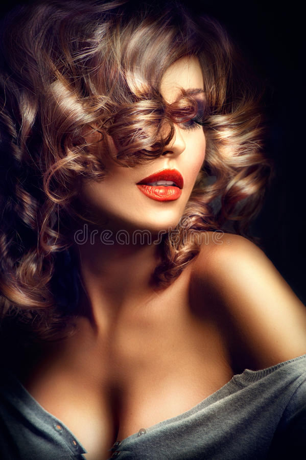 Girl. Beauty model over dark background. Girl. Beauty model posing over dark background royalty free stock image