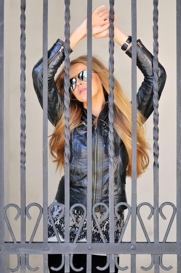 Sexy girl behind bars