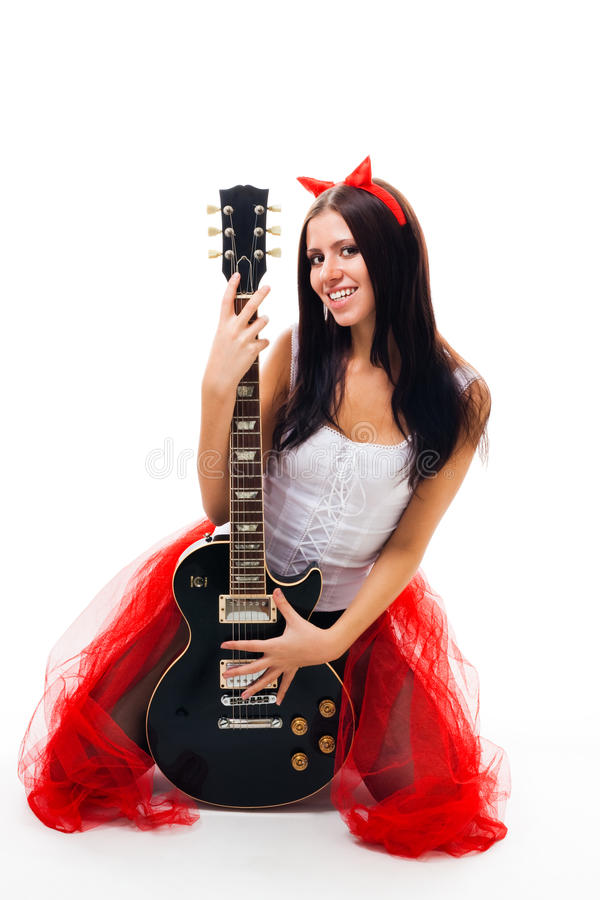 Girl With Black Guitar And Horns Royalty Free Stock Image
