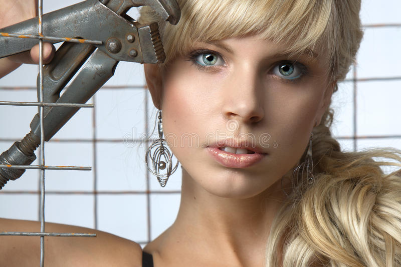 girl with blond hair and large earrings stock image