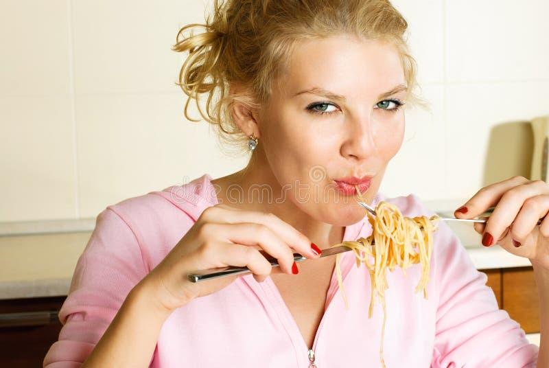 girl eating spaghetti stock images